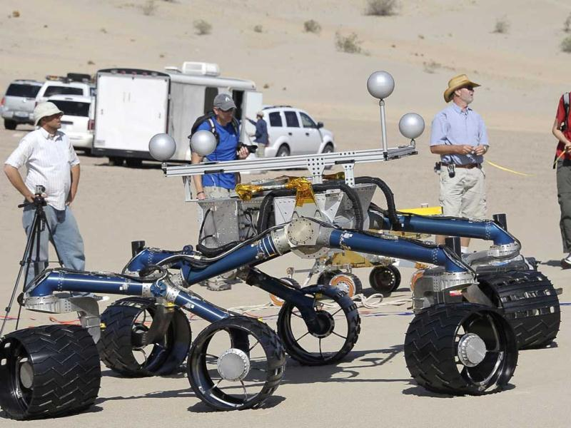 Members of the Mars Science Laboratory test out an engineering model of its next generation Mars rover, dubbed