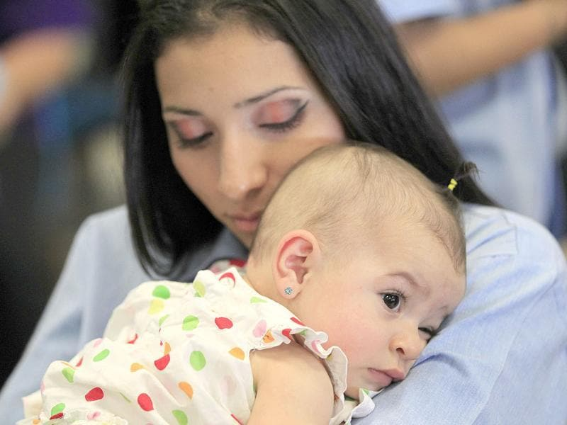 A woman hugs her baby at California Institute for Women state prison in Chino, California. Reuters/Lucy Nicholson