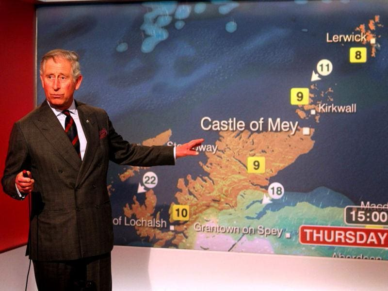 Britain's Prince Charles reads the weather in the Six O'Clock studio whilst on a tour of the BBC Scotland Headquarters in Glasgow, Scotland where they met staff to celebrate sixty years of BBC Scotland Television. AP Photo/Andrew Milligan/PA Wire