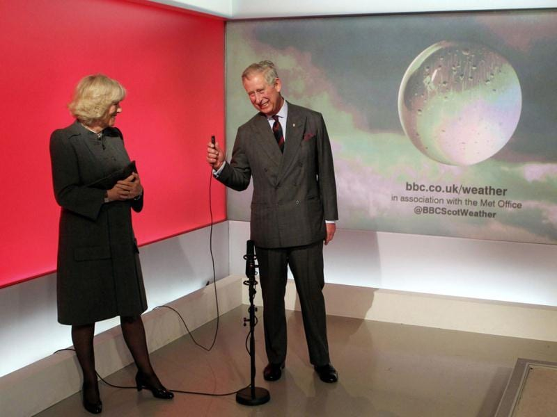 Britain's Prince Charles is watched by his wife Camilla, Duchess of Cornwall, as he presents a special weather forecast during a visit to BBC Scotland's headquarters in Glasgow, Scotland. Reuters/ Andrew Milligan/Pool