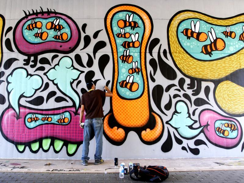Mexican artist Hugo Huitzi puts the finishing touches to his graffiti art at the Poliniza Festival of Urban Art at the Polytechnic University in Valencia. (Reuters/Heino Kalis)