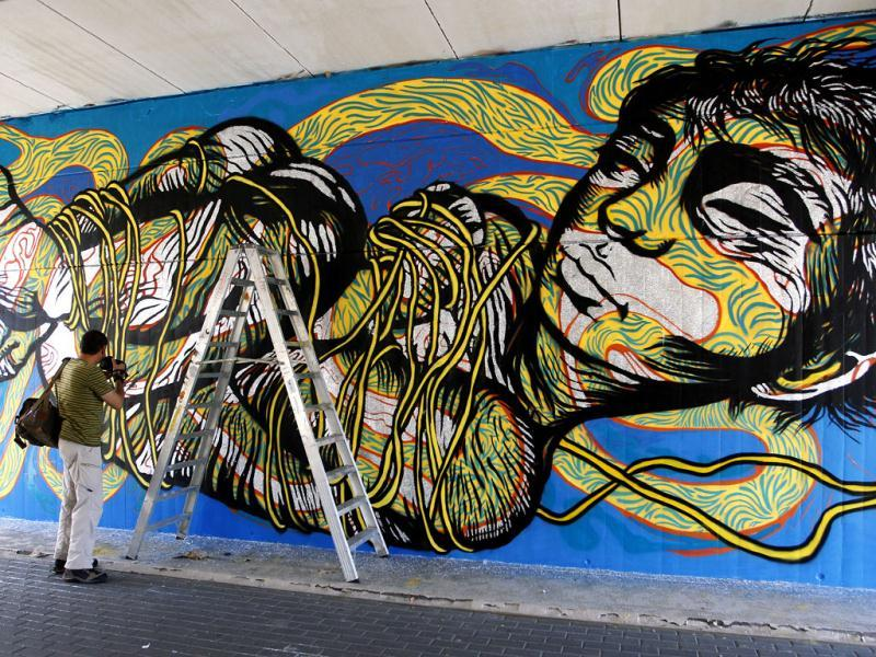 A graffiti art of Colombian artist Bastardilla is seen at the Poliniza Festival of Urban Art at the Polytechnic University in Valencia. (Reuters/Heino Kalis)