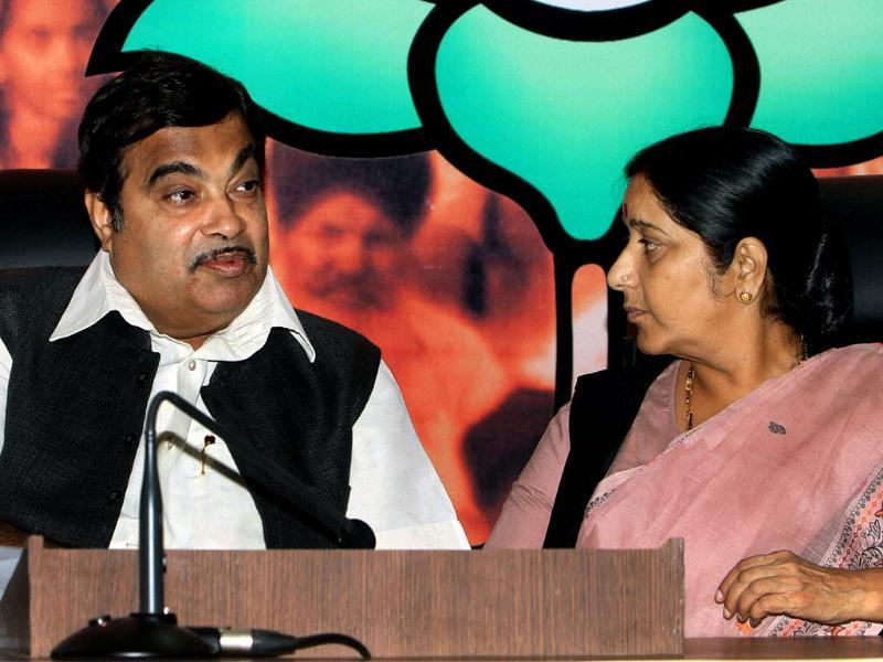 BJP president Nitin Gadkari with senior leader Sushma Swaraj at the party's Central Office Bearers' meeting in New Delhi. PTI/Manvender Vashist