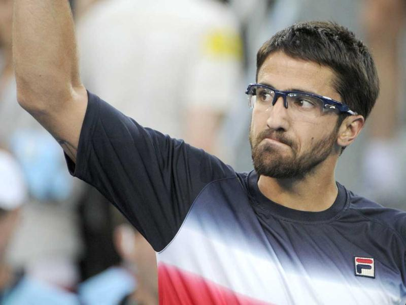 Serbian Janko Tipsarevic celebrates his victory against Serbian Novak Djokovic during their Madrid Masters tennis match. AFP Photo/Pedro Armestre