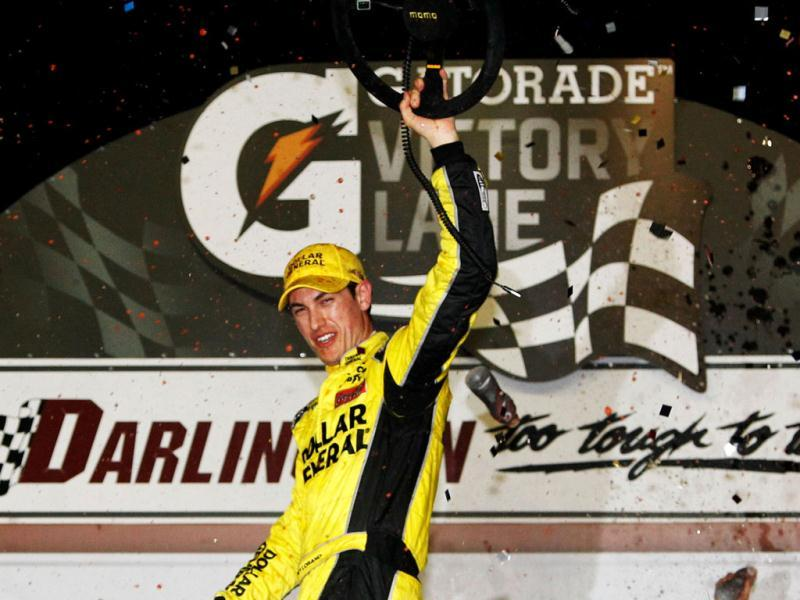 Joey Logano, driver of the #20 Dollar General Toyota, celebrates in Victory Lane after winning the NASCAR Nationwide Series VFW Sport Clips Help A Hero 200 at Darlington Raceway in Darlington, South Carolina. AFP/Tom Pennington
