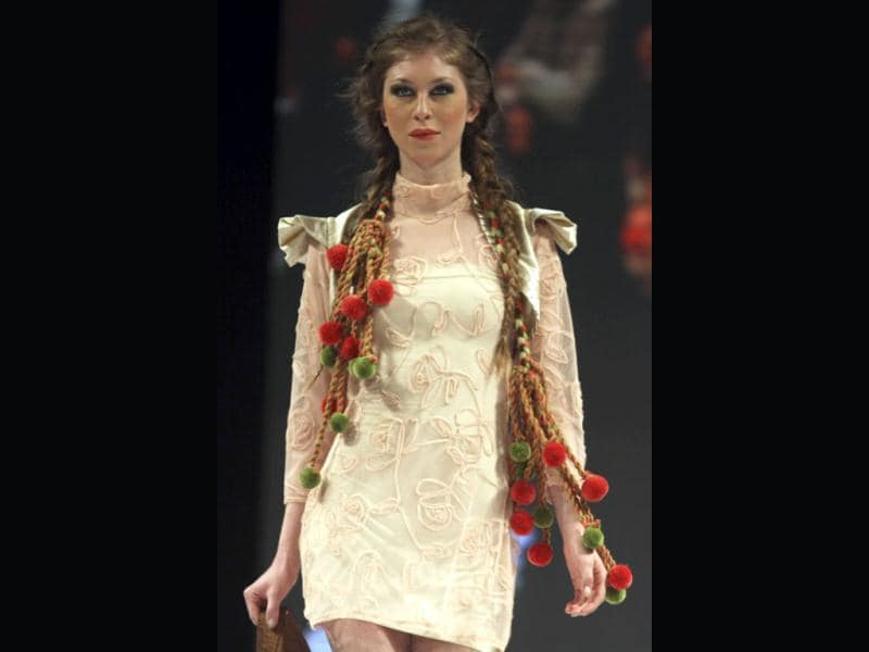 A model presents a creation inspired by native Indian culture by Colombian designer Bertha Henriquez during the