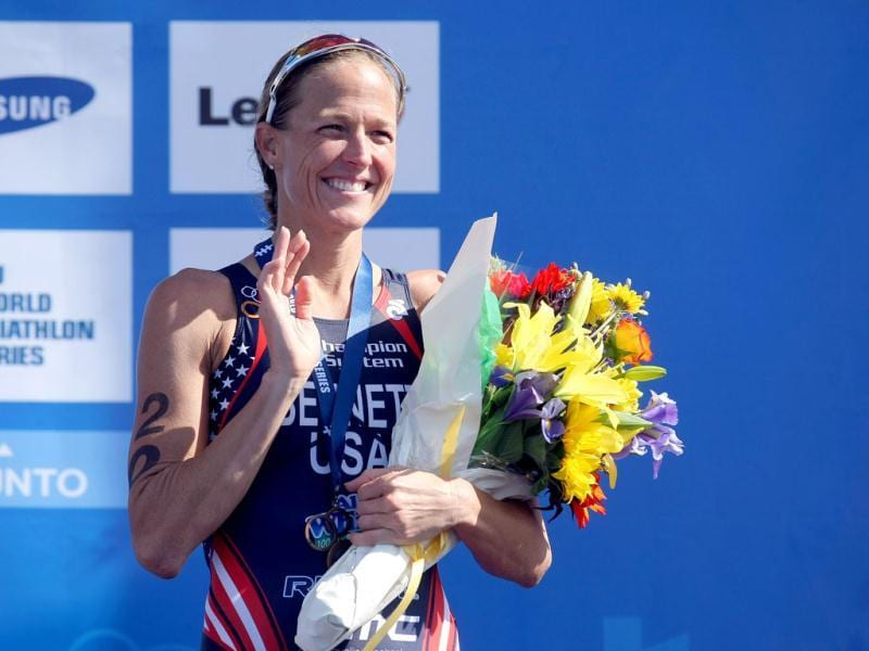 Laura Bennett #20 of the USA smiles form the podium after her 3rd place bronze medal finish during 2012 ITU World Triathlon San Diego Elite Women Race in San Diego, California. AFP/Donald Miralle