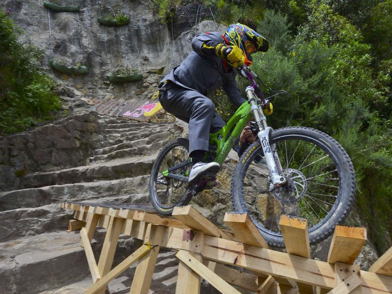 A rider takes part in the Red Bull urban downhill mountain bike race, at Mount Monserrate in Bogota. AFP Photo/Luis Acosta