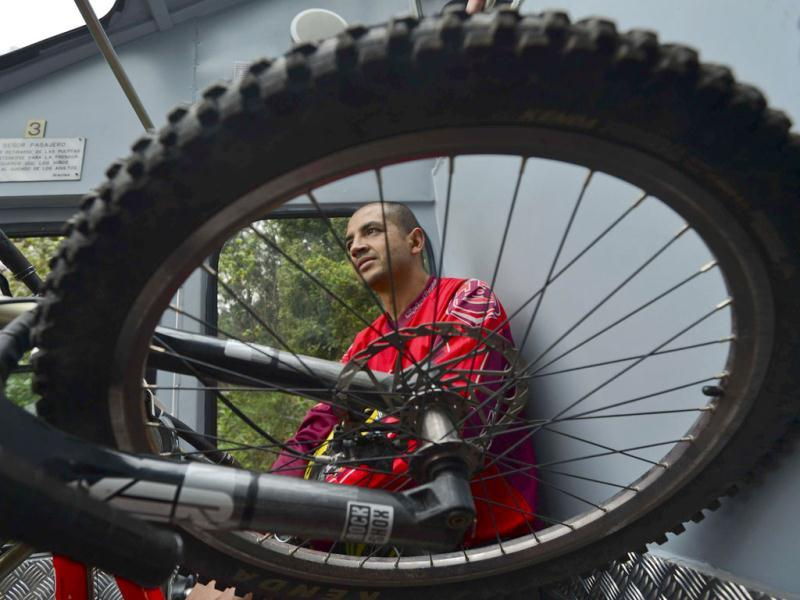 A rider waits for his turn in he Red Bull urban downhill mountain bike race, at Mount Monserrate in Bogota. AFP Photo/Luis Acosta