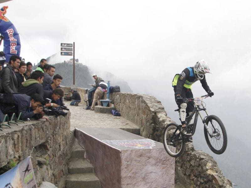 A rider launches off a jump during the Red Bull urban downhill mountain bike race in Bogota. Reuters Photo/John Vizcaino