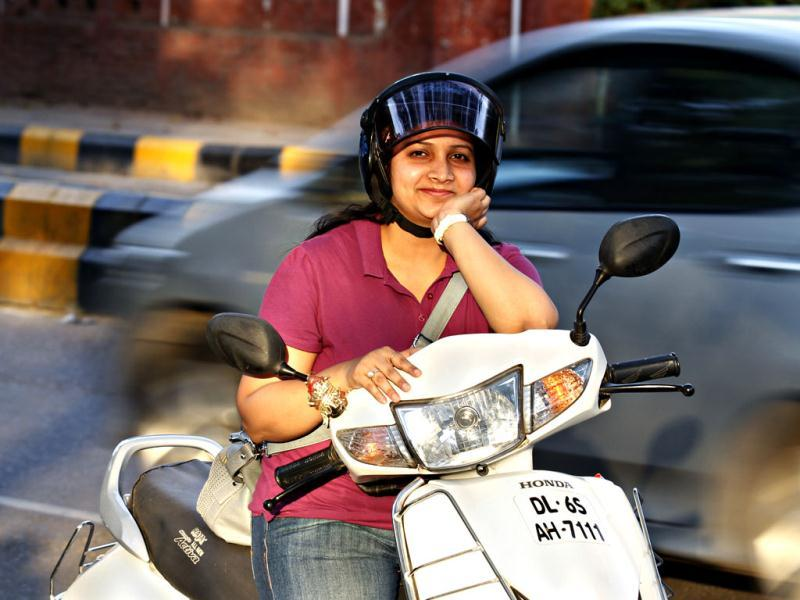 Monika Rajwaney, working with HDFC bank, Delhi, rides her scooty to office everyday. (HT/Jasjeet Plaha)