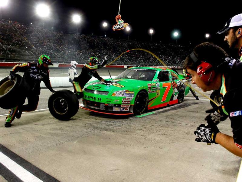 Danica Patrick, driver of the #7 GoDaddy.com Chevrolet, comes in for a pit stop during the NASCAR Nationwide Series VFW Sport Clips Help A Hero 200 at Darlington Raceway on May 11, 2012 in Darlington, South Carolina. (AFP Photo)