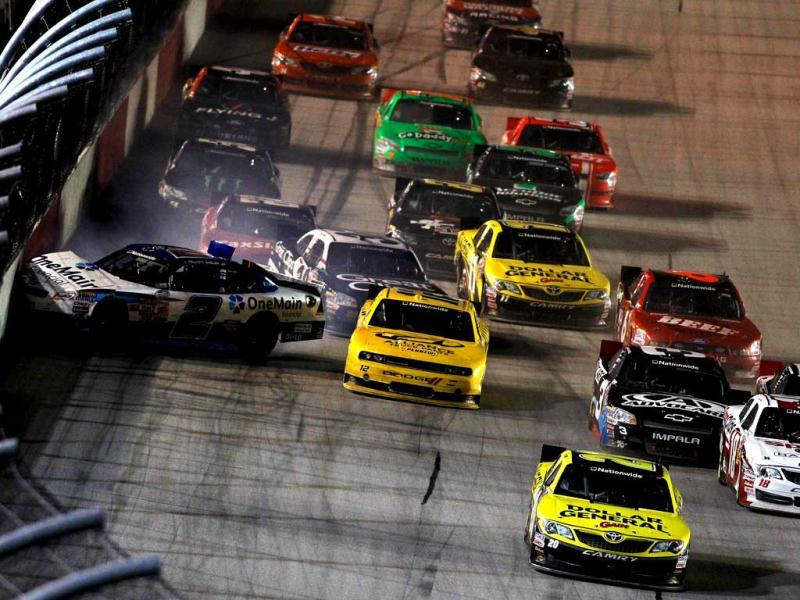 Elliott Sadler, driver of the #2 OneMain Financial Chevrolet, is turned into the wall on a late restart by Joey Logano, driver of the #20 Dollar General Toyota, during the NASCAR Nationwide Series VFW Sport Clips Help A Hero 200 at Darlington Raceway in Darlington, South Carolina.  (AFP Photo)