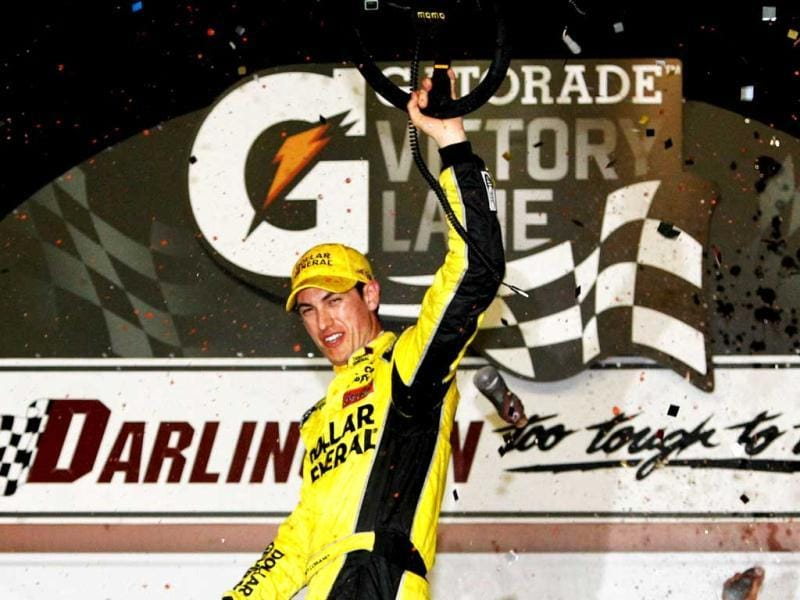 Joey Logano, driver of the #20 Dollar General Toyota, celebrates in Victory Lane after winning the NASCAR Nationwide Series VFW Sport Clips Help A Hero 200 at Darlington Raceway in Darlington, South Carolina.(AFP Photo)