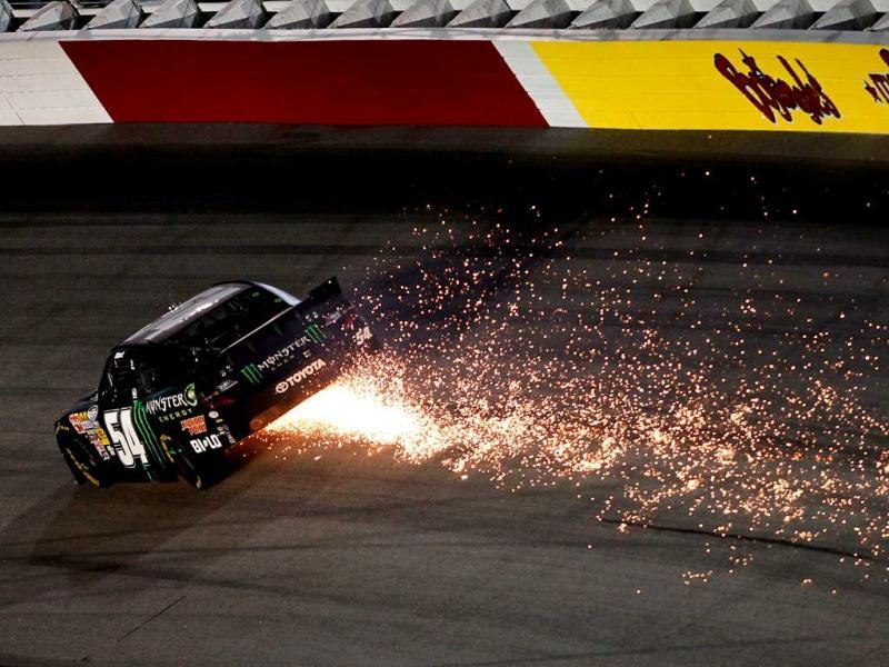 Kurt Busch, driver of the #54 Monster Energy Toyota, throws sparks on the track after making contact with the wall during the NASCAR Nationwide Series VFW Sport Clips Help A Hero 200 at Darlington Raceway in Darlington, South Carolina. (AFP Photo)