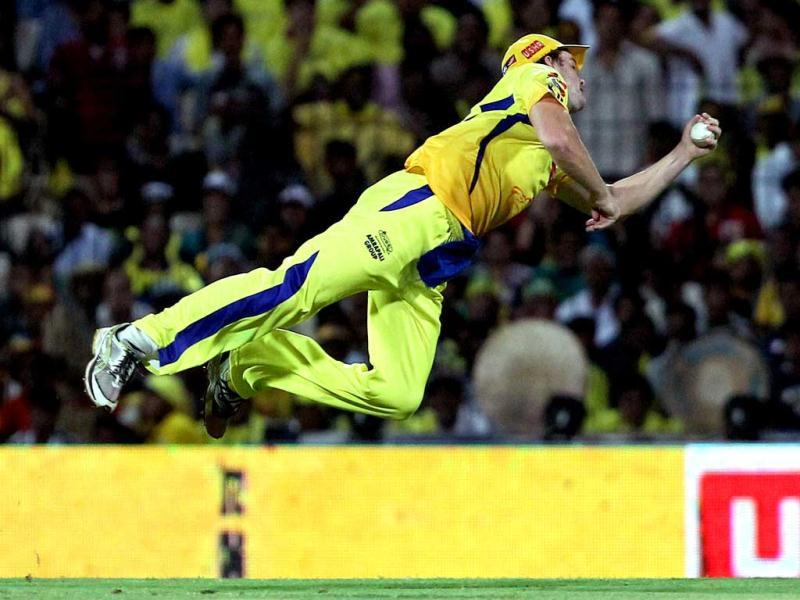 Chennai Super Kings' Albie Morkel dives to take a successful catch leading to the dismissal of Delhi Daredevils' Mahela Jayawardene during their IPL-5 match in Chennai. (PTI Photo/R Senthil Kumar)