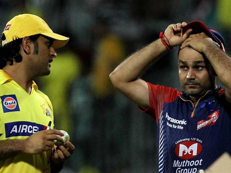 Skippers of Delhi Daredevils' Virender Sehwag and Chennai Super Kings' MS Dhoni after their IPL-5 match in Chennai. (PTI Photo/R Senthil Kumar)