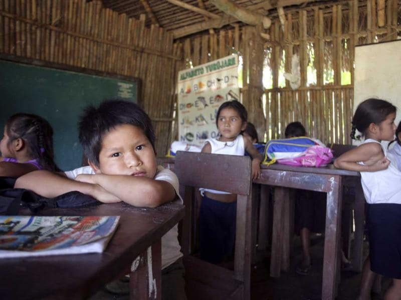 Indigenous Amazonian schoolchildren sit in a classroom in Santa Clara in the Isiboro Secure National Park and Indigenous Territory (TIPNIS), some 400 km (249 miles) northeast of La Paz. Reuters/Gaston Brito