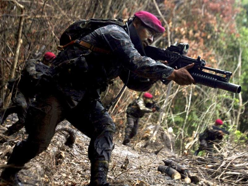 Kaibiles, members of an elite group of the Guatemalan army, participate in an anti-terrorism jungle exercise demonstration near their base in Poptum, Peten, 400 km (248 miles) from Guatemala City. The Kaibil was founded in 1974 and is currently involved in the fight against Mexican drug cartels, particularly against the Los Zetas, according to the spokesperson for the Ministry of Defense of Guatemala. (Reuters)