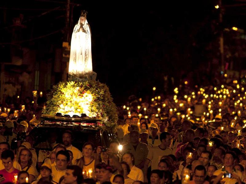 Roman Catholics participate in the procession of candles in the streets around the Our Lady of Fatima shrine in Belem, May 12, 2012. Brazilians have been honoring the Virgin Mary with this annual procession since 1966. The Virgin Mary reportedly appeared to three shepherd children at Fatima in Portugal in 1917. REUTERS/Paulo Santos