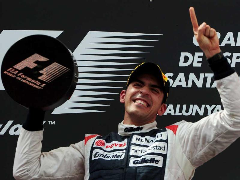 William's Venezuelan driver Pastor Maldonado celebrates on the podium at the Circuit de Catalunya in Montmelo on the outskirts of Barcelona during the Spanish Formula One Grand Prix. AFP/Dimitar Dilkoff