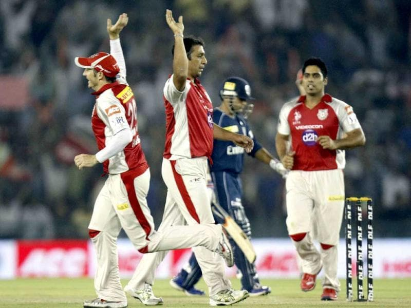 Azar Mahmood players of Kings XI Punjab bowler celebrates with other players after dismissal of Parthiv Patel of Deccan Chargers during the IPL Twenty 20 cricket match at PCA Stadium, Mohali, Gurpreet Singh/HT