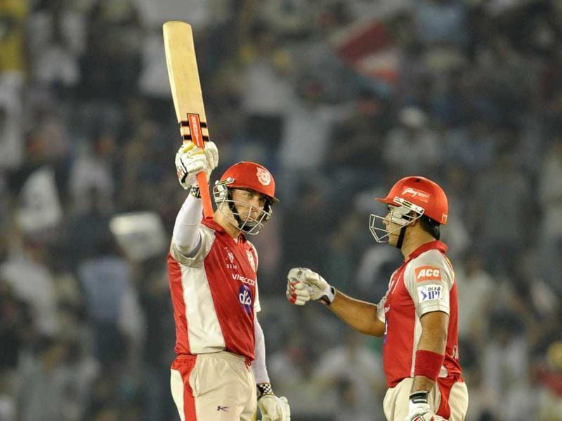 Kings XI Punjab batsman David Hussey (L) celebrates his half century (50 Runs) during the IPL Twenty20 cricket match between Kings XI Punjab and Deccan Chargers at Punjab Cricket Association (PCA) stadium in Mohali . AFP Photo/Sajjad Hussain