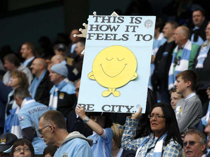 Manchester City supporters hold up a placard during their English Premier League soccer match against Queens Park Rangers at the Etihad Stadium in Manchester, northern England. Reuters/Darren Staples