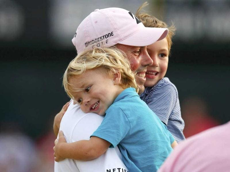 Matt Kuchar of the US is hugged by his sons, Carson, 2 and Cameron, 4, after he won the Players Championship PGA golf tournament at TPC Sawgrass in Ponte Vedra Beach. Reuters/Chris Keane