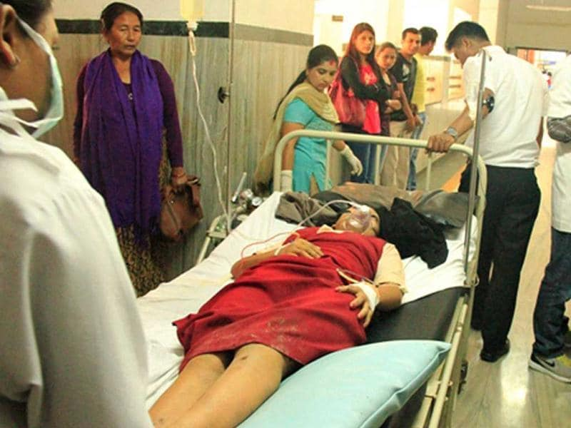 Agni Air flight attendant, Roshni Saiju, who survived a plane crash near Jomsom Airport, receives medical attention at a hospital in Pokhara, some 200 kms west of Kathmandu. (AFP Photo)