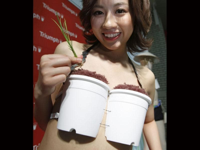 A model wears Triumph International's Grow-Your-Own-Rice bra in Tokyo. The bra, which transforms into a rice growing kit, allows the wearer to cultivate rice anytime, anywhere. Reuters/Yuriko Nakao