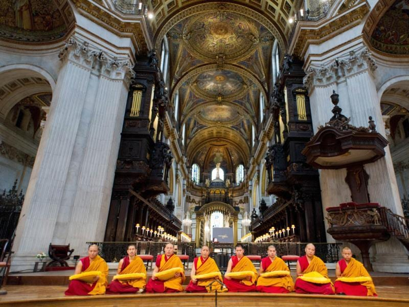 Monks chant ahead of the arrival of The Dalai Lama as he attends a ceremony in St Paul's Cathedral in central London, to receive the 2012 Templeton Prize. AFP Photo/Leon Neal