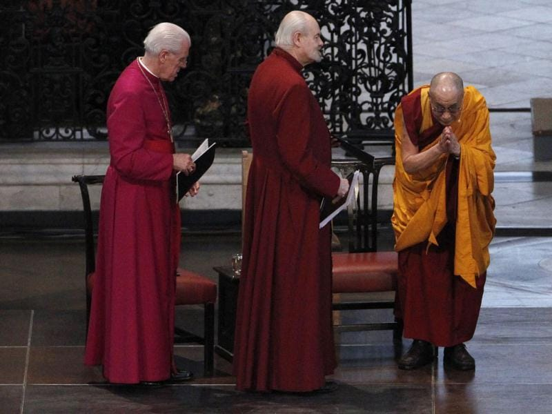 The Dalai Lama (R) gestures as he is awarded the Templeton Prize during his first visit to St Paul's Cathedral in London. The Templeton Prize valued at 1.1m pounds ($1.7) is the world's largest award given to an individual, honouring a living person for making exceptional contributions to spiritual life. Reuters/Stefan Wermuth