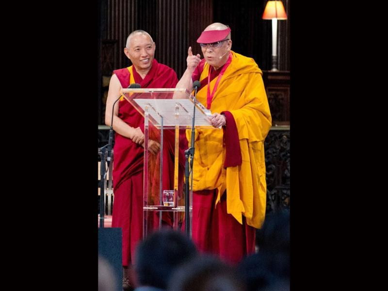 The Dalai Lama (R) speaks to the audience during a ceremony in St Paul's Cathedral in central London, in which he received the 2012 Templeton Prize. AFP Photo/Leon Neal