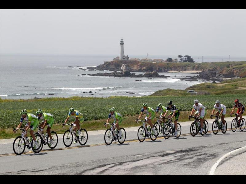 Team Liquigas Cannondale including race leader Peter Sagan, of Slovakia, third from left, leads the field along Highway 1 past the Pigeon Point Lighthouse during Stage 2 of the Tour of California cycling race in Pescadero, California. (AP Photo/Marcio Jose Sanchez)