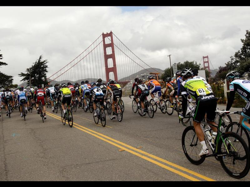 The peloton rides next to the Golden Gate bridge during Stage 2 of the Tour of California cycling race in San Francisco. (AP Photo/Marcio Jose Sanchez)