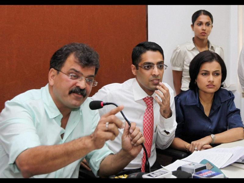 Indian Pilots Guild (IPG) president Jitendra Awhad, left, speaks as IPG leaders Tauseef Muqaddam and Priya Acharya look on during a press conference in Mumbai. (PTI Photo)