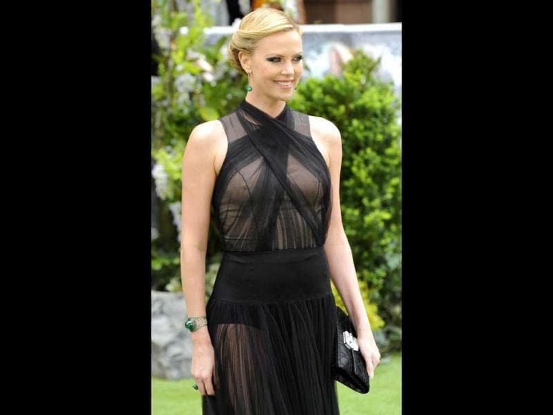 Charlize's strategically placed nude fabric adds tremendously to the sensual appeal of her dress.