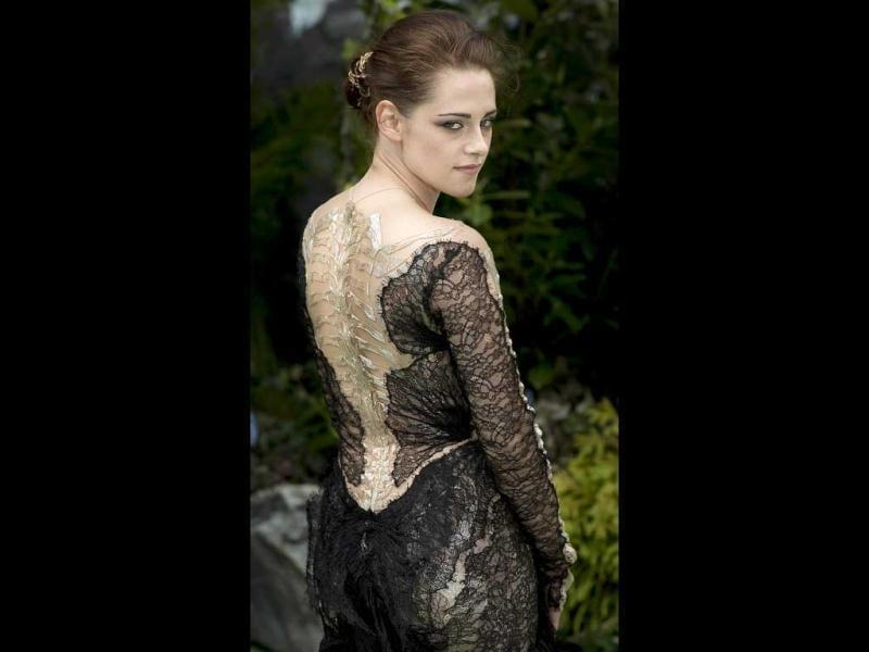 Kristen Stewart shows off the intricate pattern at the back of her lace dress.