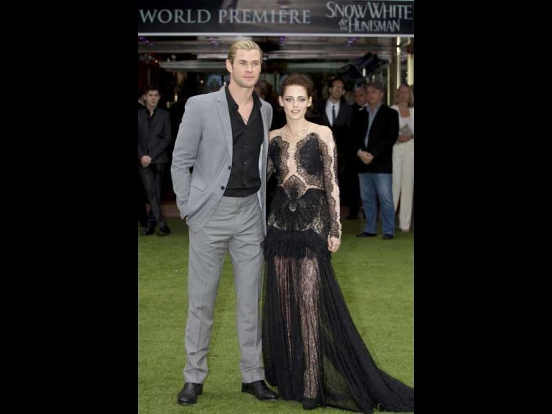 Chris Hemsworth and Kristen Stewart pose at The Snow White and the Huntsman world premiere.