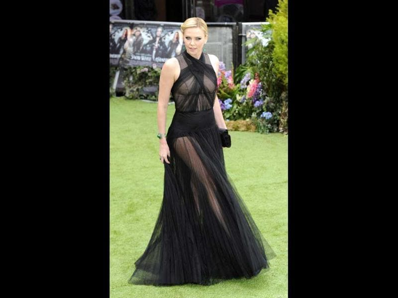 Charlize Theron left little to imagination in the black gown and the skin show only adds to the effect.