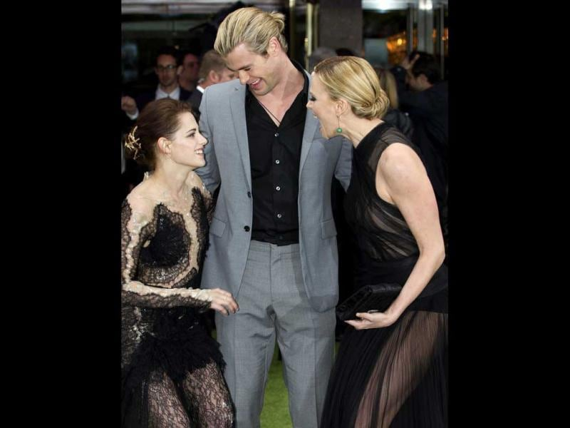 The Snow White and the Huntsman actors caught candid sharing a light moment at the film's world premiere.