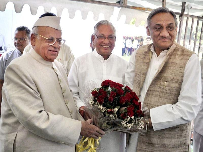 Governor of Uttarakhand Aziz Qureshi being greeted by Uttarakhand chief minister Vijay Bahuguna and Vidhan Sabha Speaker Govind Singh Kunjwal after he took oath of office at Raj Bhawan in Dehradun. PTI