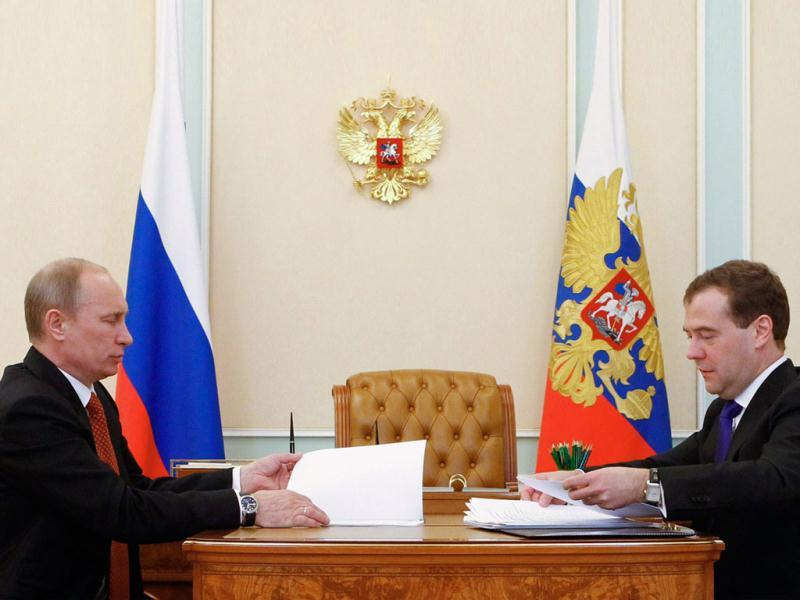 Russia's newly-assigned President Vladimir Putin and Prime Minister Dmitry Medvedev meet in the Kremlin in Moscow. AFP