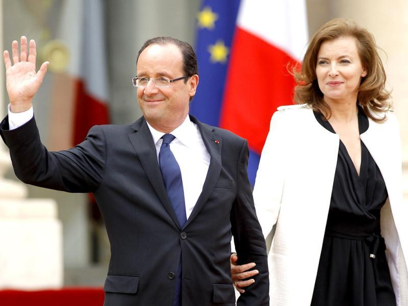 France's new President Francois Hollande and his companion Valerie Trierweiler leave the Elysee Palace after the handover ceremony in Paris. Reuters/Benoit Tessier