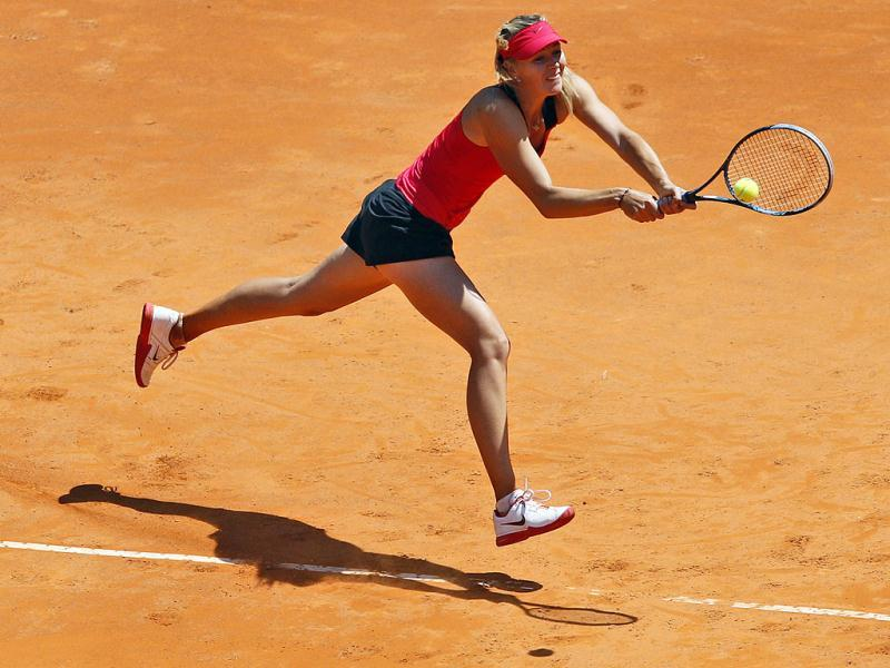 Russia's Maria Sharapova returns the ball to Christina McHale of the United States at the Italian Open tennis tournament, in Rome. AP/Andrew Medichini