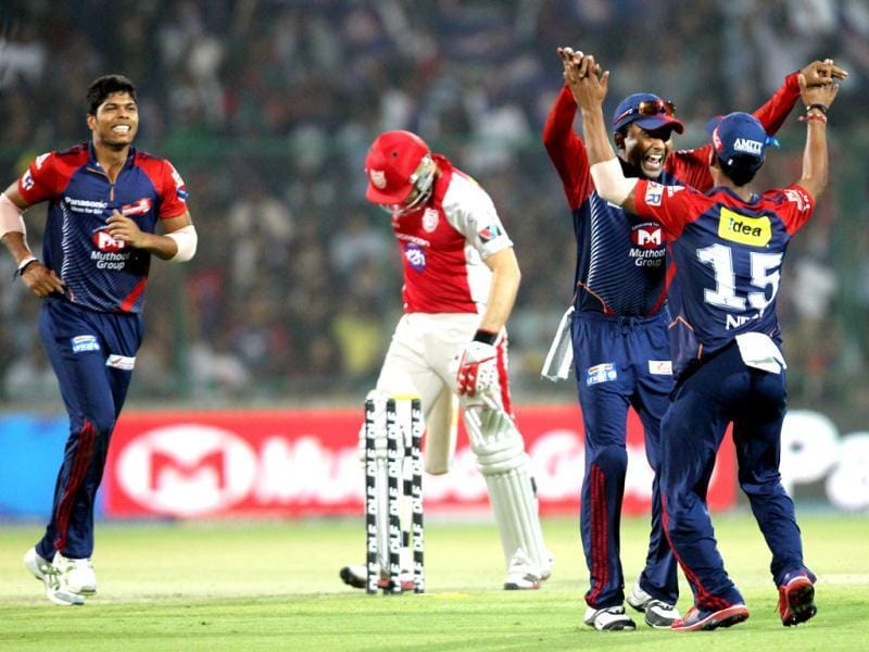 Delhi Daredevils Pawan Negi congratulated by Mahela Jayawardene after he run out the Punjab kings XI David Miller during the IPL cricket match in New Delhi. HT Photo/Ajay Aggarwal