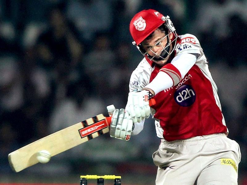Kings XI Punjab's David Hussey plays a shot against Delhi Daredevils during their IPL-5 match in New Delhi. PTI Photo/Aman Sharma