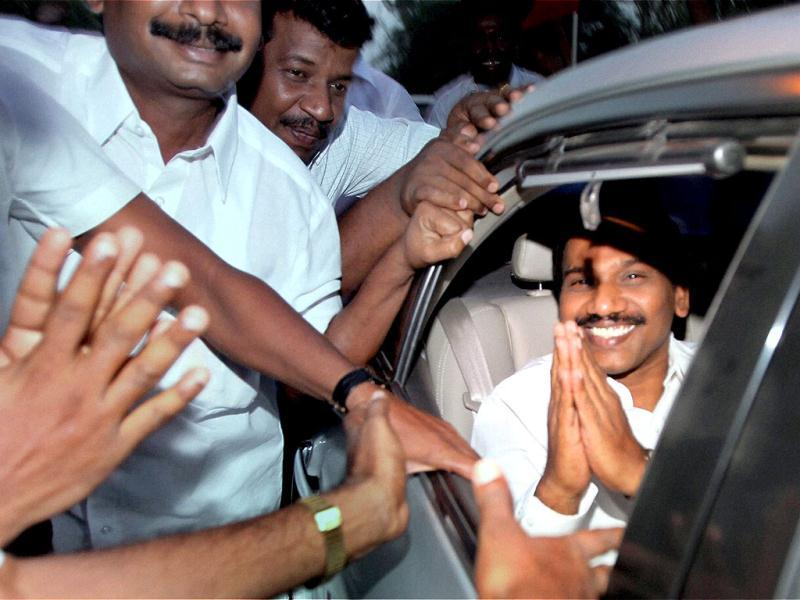 Former telecom minister A Raja greets his supporters as he leaves in a car after his release from Tihar Jail in New Delhi. PTI/Atul Yadav
