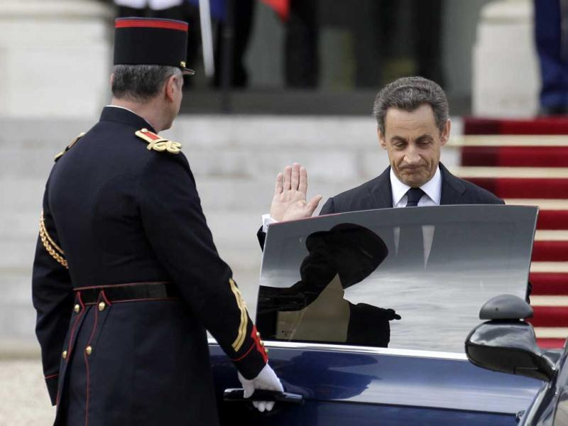 Outgoing French president Nicolas Sarkozy leaves the Elysee Palace after the handover ceremony with new President Francois Hollande in Paris. AP/Michel Euler
